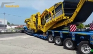 Keestrack H6e, full hybrid plug-in cone crusher on transport